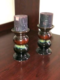 two brown-and-green ceramic candlesticks