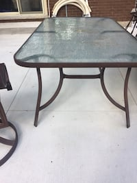 Brown metal framed glass top table London, N6H 1G6