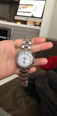 round silver-colored chronograph watch with link bracelet Calgary, T2R 1M3