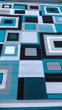Blue, white, and black area rug