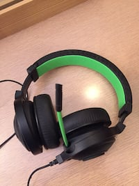 black and green corded headphones