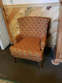 brown wooden framed brown and red floral padded armchair 196 mi