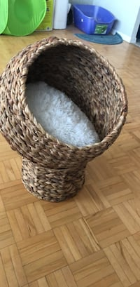 Brown and white woven basket bed for your cat or small animal