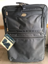 Jaguar Navy luggage. Tags still on & perfect condition inside, but distu and some staining on outside from sitting in storage. 2 wheeler. Mississauga, L5N