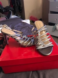 pair of gray open-toe ankle strap heels 1692 mi