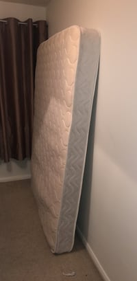 white and gray mattress in pack