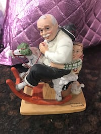 White and black ceramic figurine Norman Rockwell Christmas
