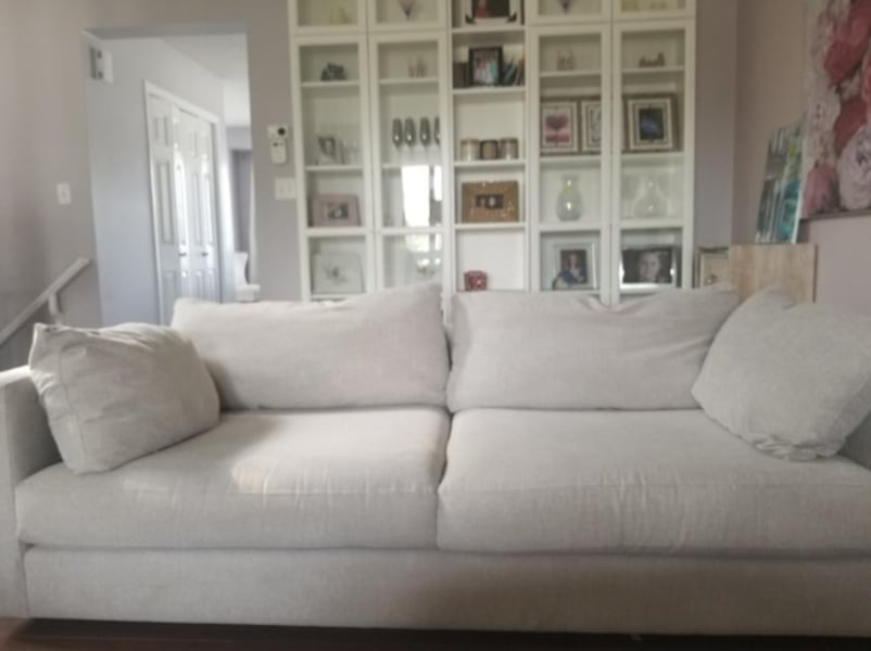 Well taken care of grey canvas sofa. Pirced to move 1245bd26-d1d7-4f6e-84b8-b2a9927983a3
