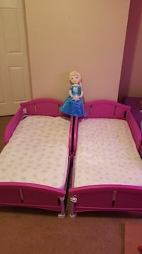 toddler's white and red bed mattress