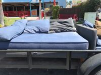 gray wooden bed and blue mattress