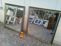 two square brown-framed mirrors
