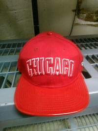 red and white fitted cap 104 mi