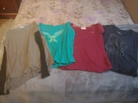 4 ladies tops. Size L. 2 t-shirts & 2 long sleeves Barrie, L4M 6Z8