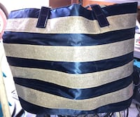 Large silver blinged striped bag located off Cheyenne & Decatur no rips or tears $5
