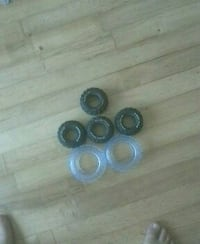 four black and two white toy car wheels