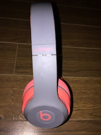 gray and red Beats by Dr. Dre Beats Wireless headphones