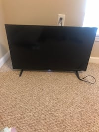 black flat screen TV with remote Warren