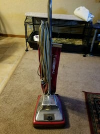 blue and gray upright vacuum cleaner