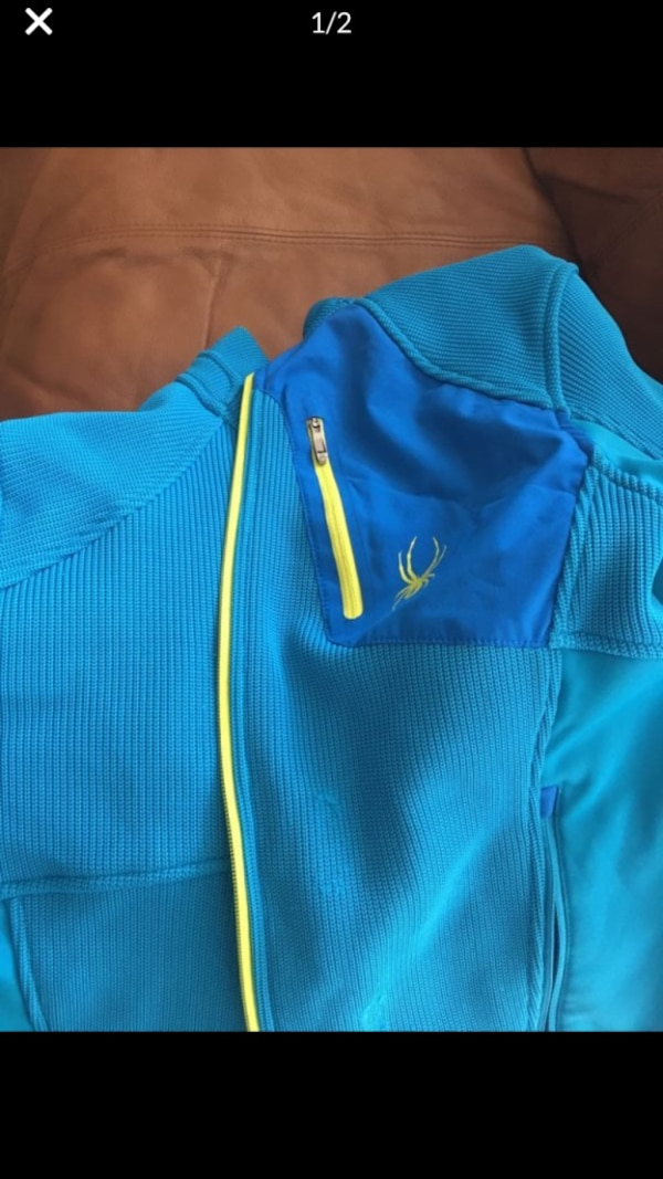 blue and green zip-up jacket 6e834f73-60bd-4875-829a-1163ce77c0fe