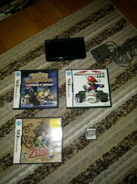 Nintendo DS game console with game cases Niagara Falls, L2G 3V6