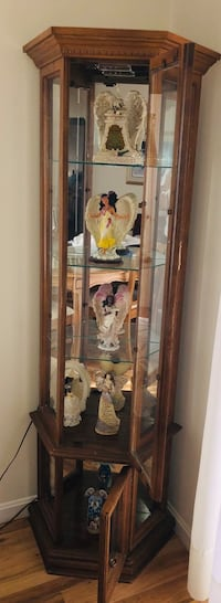 Wooden Curio Cabinet- angels not included. Cash only. You pick up and move. Location Willow Grove, PA 19090 Willow Grove