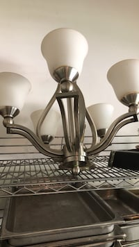 Stainless steel chandelier, hard wire into the ceiling and your lit ! Neptune, 07753