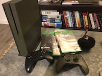 Xbox one console with controller and game cases 2298 mi