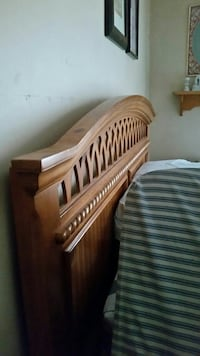brown wooden headboard.  Bed room set with mattres