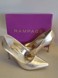 pair of shiny gold Rampage snakeskin pointed-toe