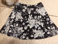 Girls size 7/8 black /white floral skirt. BNWOT