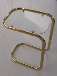 clear glass-top side table with brass base
