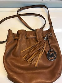 Authentic MK Leather Purse used a few times in smoke free and pet free home pickup Kennedy and sandalwood Brampton