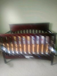 brown wooden bed frame and mattress Jacksonville, 32219