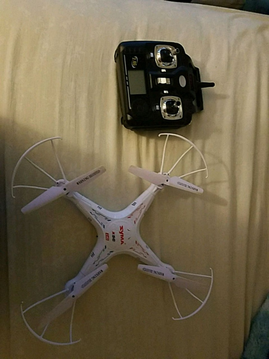 white and black quadcopter drone for sale  Sparks