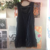 amazing little lace dress with ruffles at the bottom! fits an xs-s Vancouver, V5Z 2E5