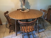 oval brown wooden table with four chairs dining set Central Okanagan, V4T 1H4