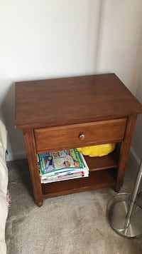 brown wooden single drawer bedside table