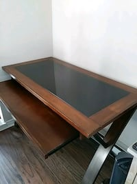 Rectangular brown wooden desk with glass top Vancouver, V6K 2N2