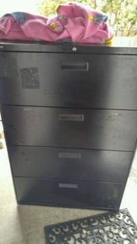 Two HON Lateral 4 drawer filing cabinet
