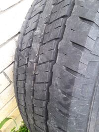 Almost new 225/75/R16 tire with Chevy rim