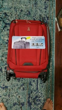 red and black carry on luggage 831 mi