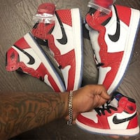 pair of red-and-white Nike basketball shoes 2275 mi