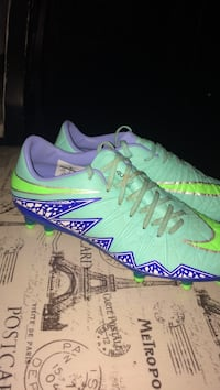 Pair of green-and-blue nike cleats