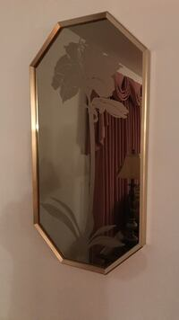 octagonal gold-colored frame mirror