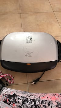 gray and black Lean Mean Fat grilling machine