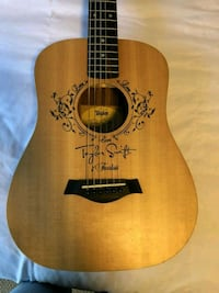 brown and black acoustic guitar Ocala