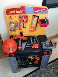 Kids work bench with lots of extra tools and toolbox