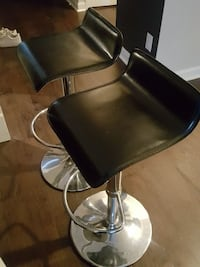 Twin stool leather chairs, being sold together