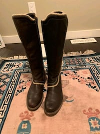 pair of black leather round toe knee-high boots Lloydminster, S9V 2E6