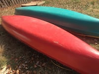 two red and blue canoe boats